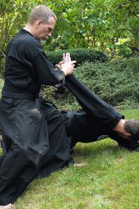 Sensei Greg Shreve puts a downward wrist lock on Sensie Brian Stouder