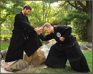 Sensei Brian Stouder puts a forward wrist lock on Sensei Greg Shreve